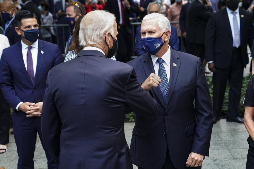 Comforting families, warning foes: Biden, Trump mark 9/11 ...
